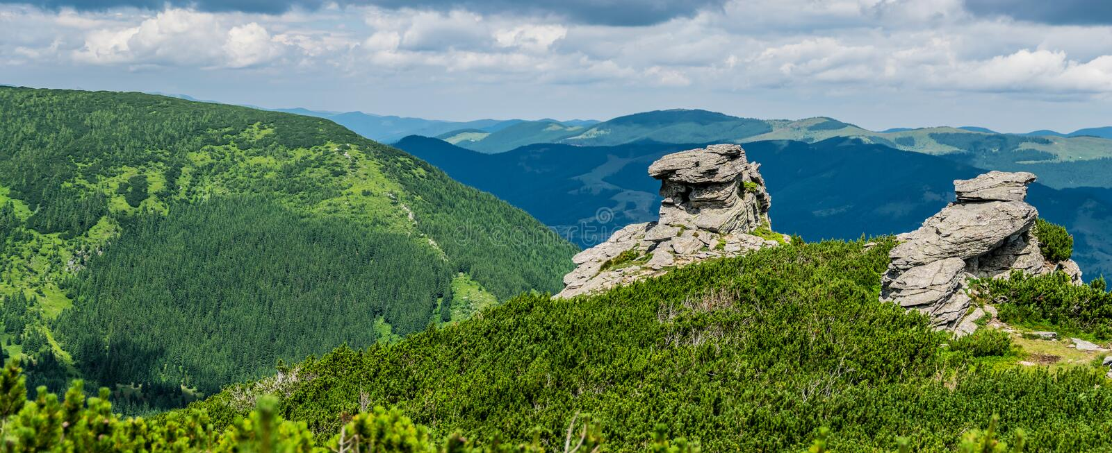 Rocks and green mountains royalty free stock photography
