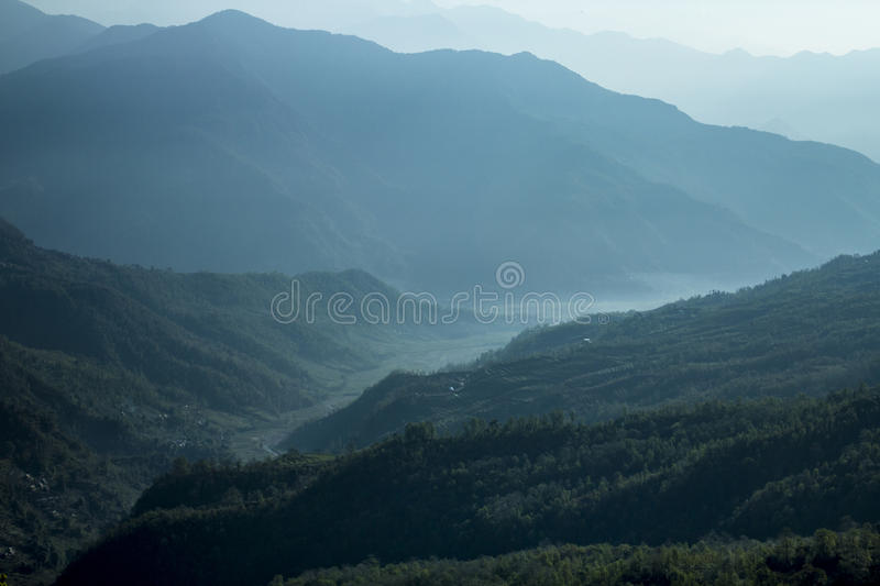 Green landscape soothing view. Visual relaxation from a soothing view of layered mountains stock images