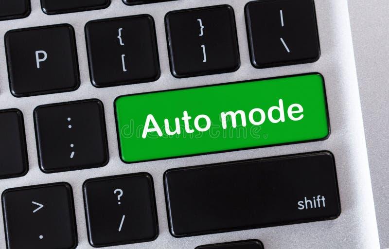 Green laptop button with text Auto mode. Automatization concept. Green laptop button with text Auto mode, closeup stock photography