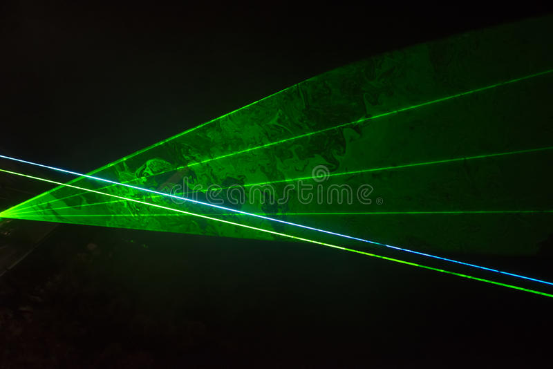 Green laser beams stock photo