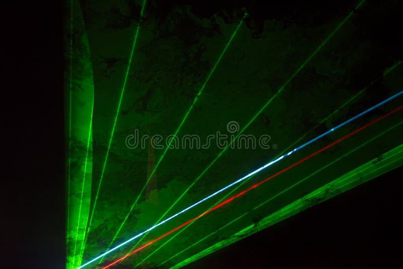 Green laser beams royalty free stock photos