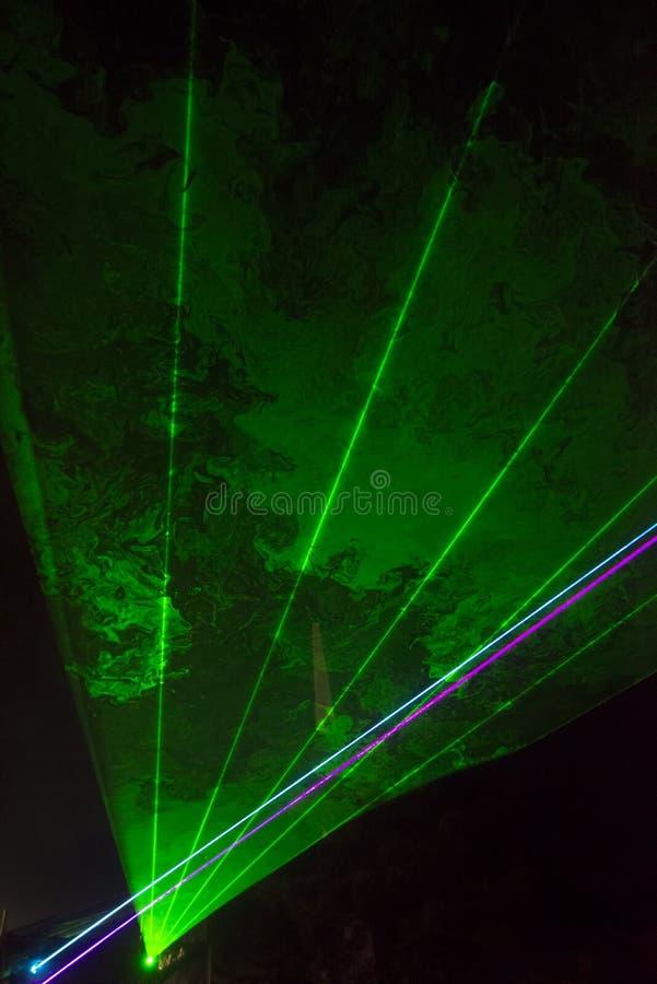 Green laser beams stock image