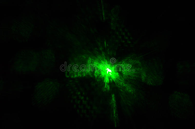 Green laser light glowing in the dark in the night club royalty free stock photo