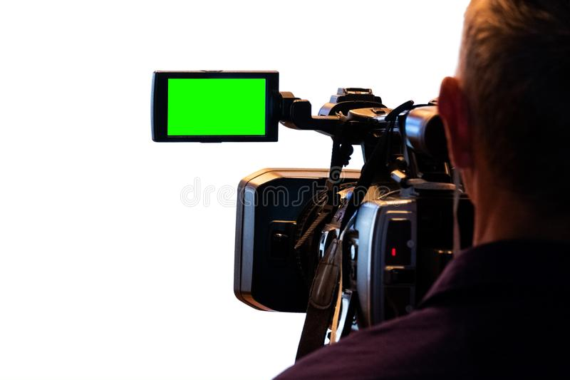 Green LCD display on high definition television camera. Isolated on white background. Videographer at work removes the story for royalty free stock image