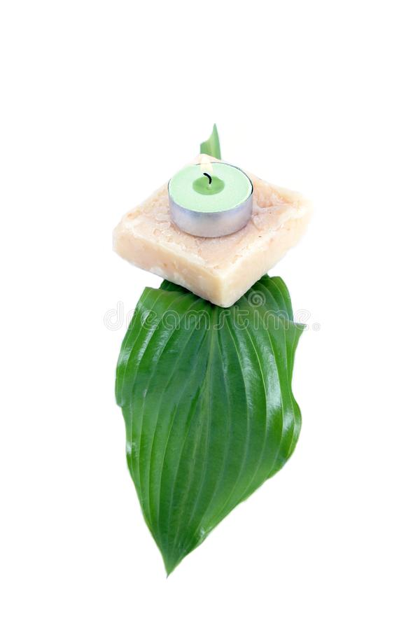 Green leaf, soap and candle royalty free stock photo