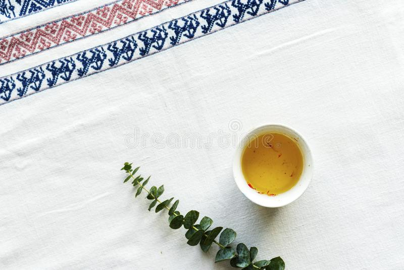 Green Leafed Plant Beside Sauce on White Table Mat royalty free stock image