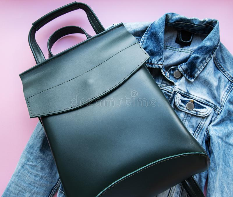 Green leather backpack. And womens clothing, flat lay royalty free stock photo