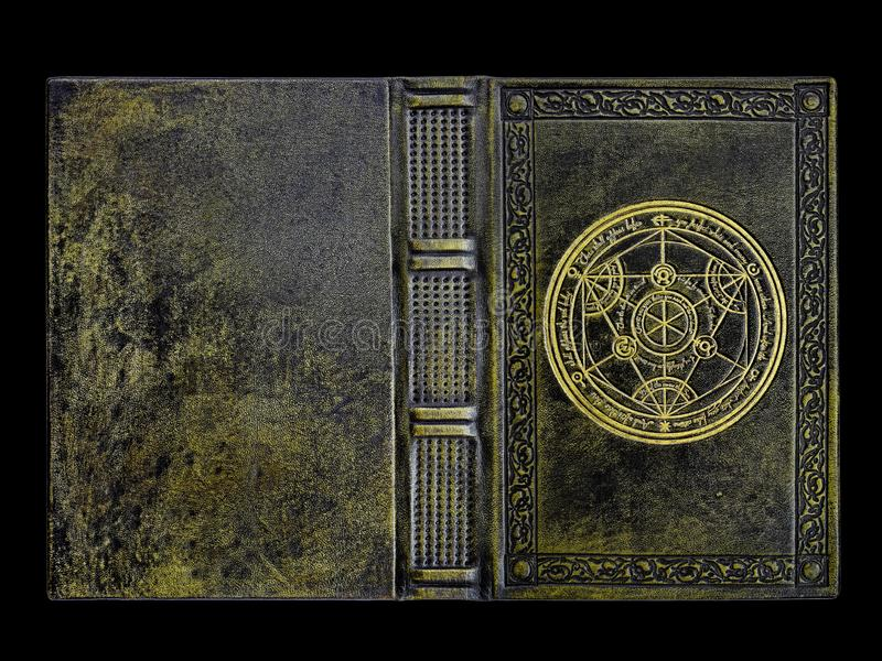 Green leather bound book with a gilded transmutation circle in center of the front cover royalty free stock photography