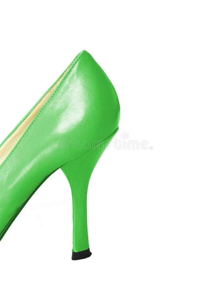 Green Leather High Heel Shoe. A woman's leather high heeled shoe on a white background royalty free stock photography