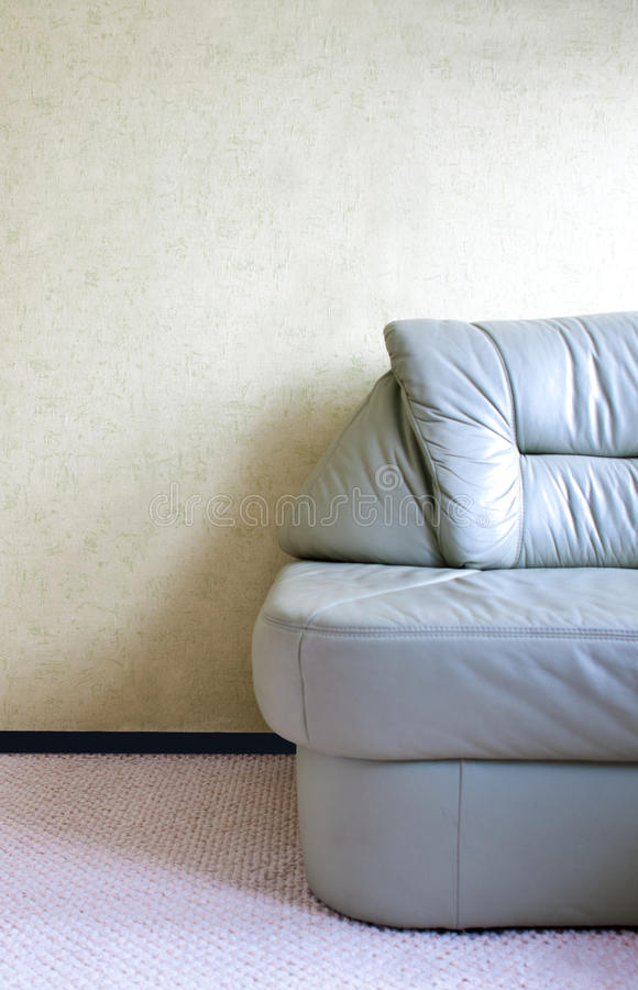 Green leather sofa royalty free stock images