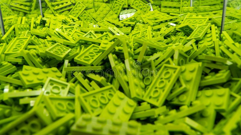 Green Lego blocks, plastic construction toy, manufactured by The Lego Group based in Denmark. London, UK - January 2019: Green Lego blocks, plastic construction stock photos