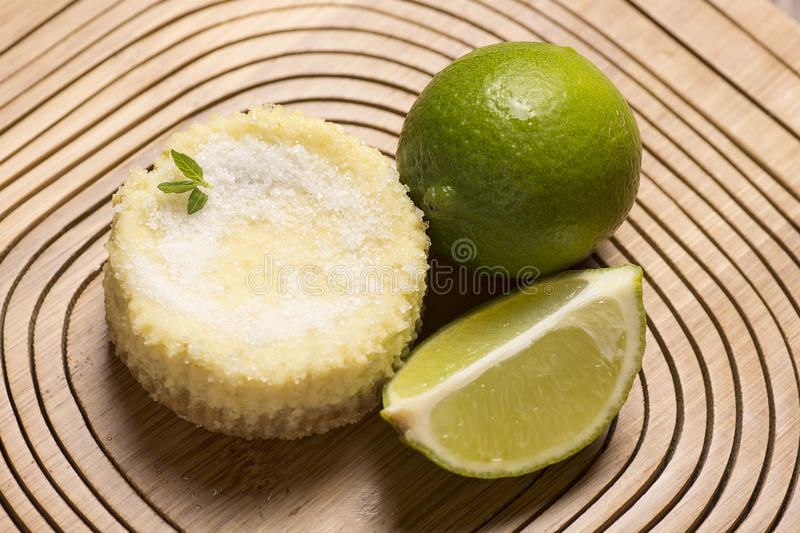 green lemon tart and mint on wooden background stock photography