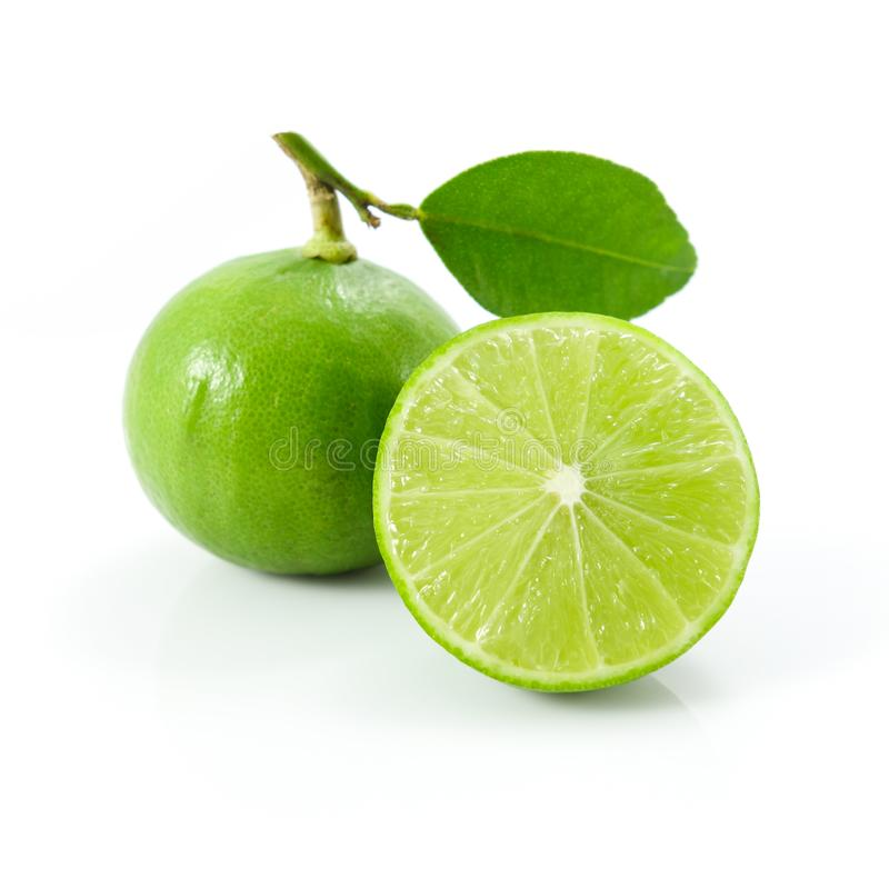 Green lemons or lime with leaf isolated on white stock images
