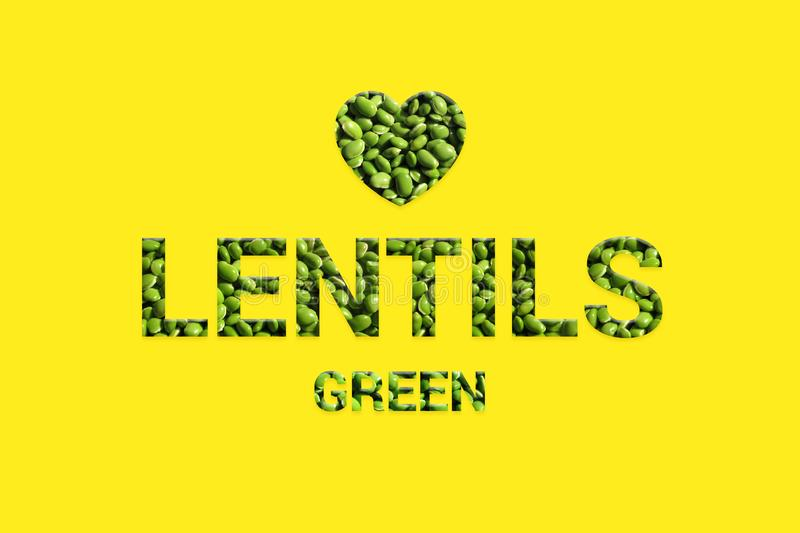 Green lentils texture text with heart shape on yellow background. royalty free stock photo