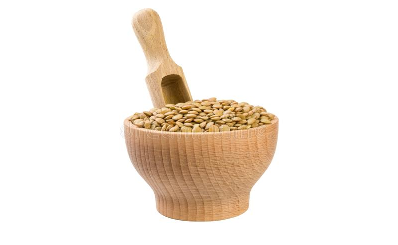Green lentils in wooden bowl and scoop isolated on white background. nutrition. bio. natural food ingredient royalty free stock image