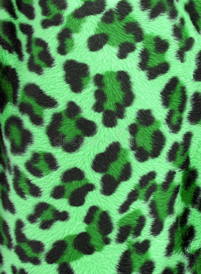 Green leopard faux fur background. Green and black camouflage faux fur leopard print backgound royalty free stock photography