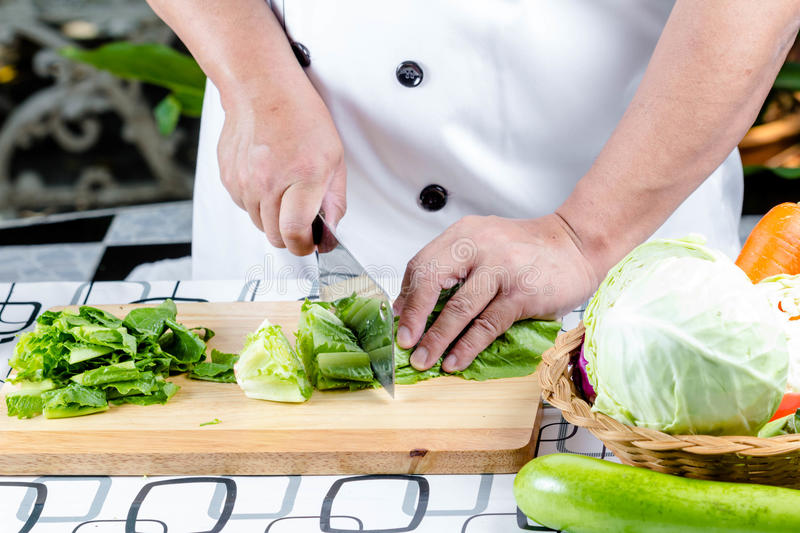 Green lettuce on wooden board stock photography