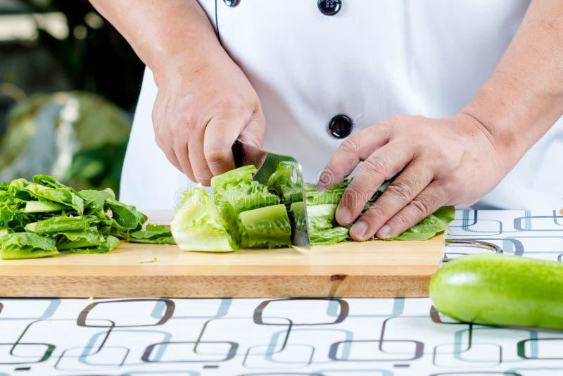 Green lettuce on wooden board royalty free stock photo