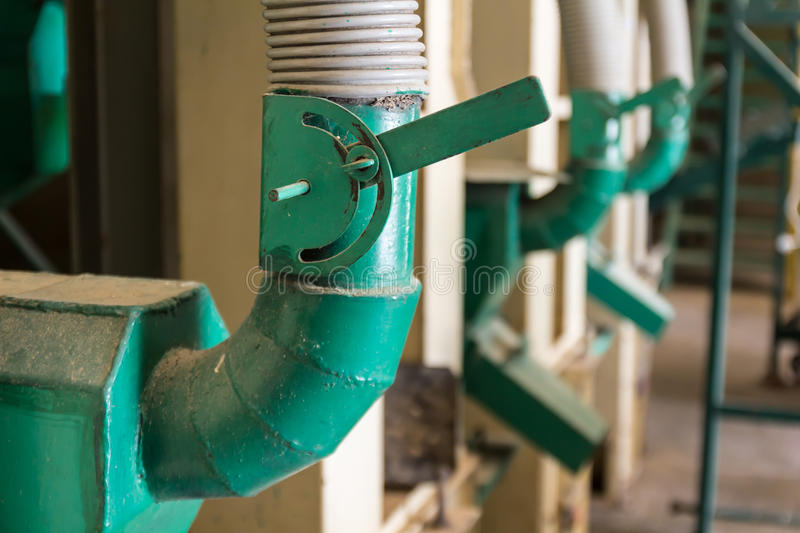 Green Lever control. In the rice mill stock photos