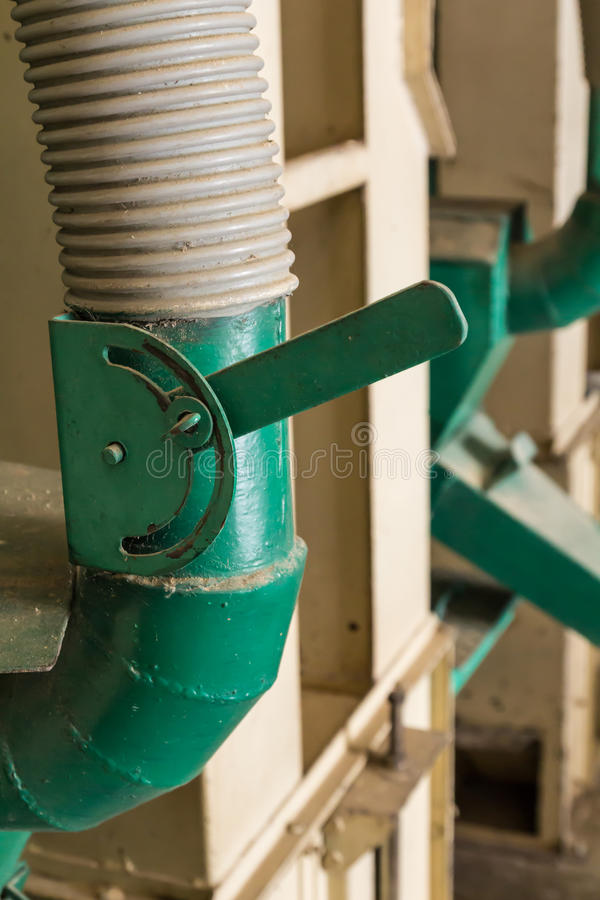 Green Lever control. In the rice mill stock photography