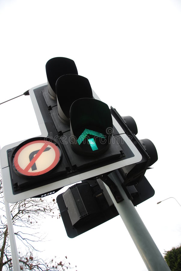 Green light 3. Close-up of green arrow traffic light as a metaphor for progress stock image