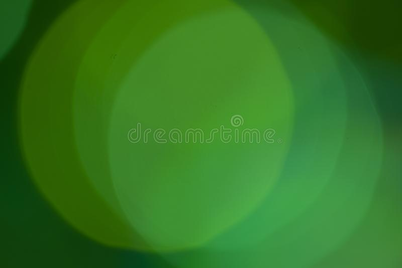 Green light bokeh background- abstract texture with highlights stock photo