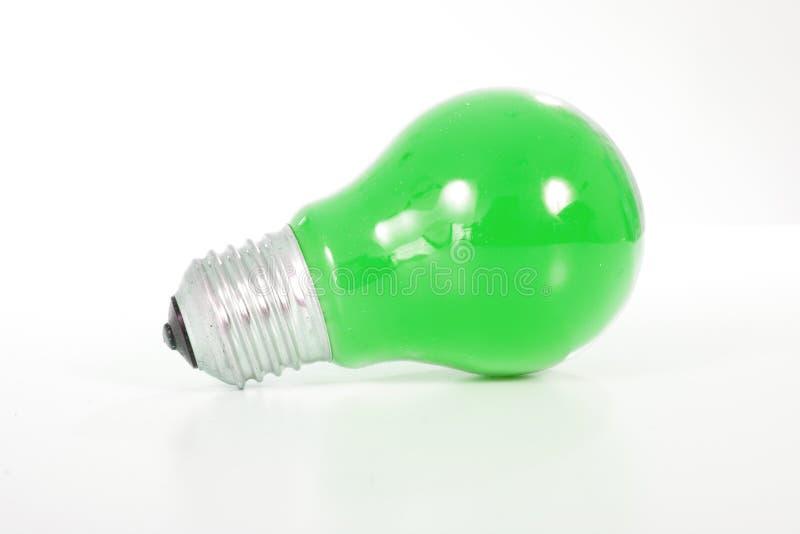 Green light bulb. Classic shape bulb with green color. stock photos