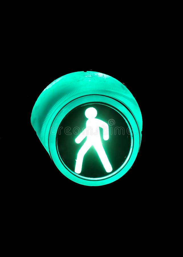 Green light at traffic lights for pedestrians to cross the road. royalty free stock image
