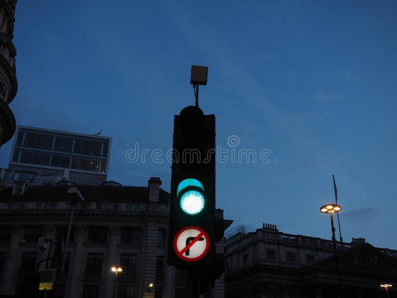 Green light traffic signal. Traffic signal green light meaning go if the way is clear. View at twilight blue hour before sunset stock image