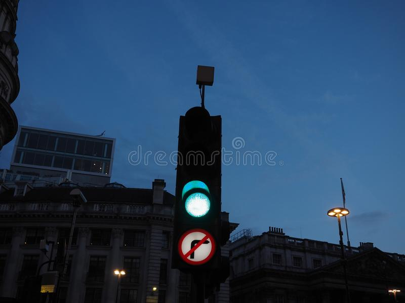 Green light traffic signal. Traffic signal green light meaning go if the way is clear. View at twilight blue hour before sunset stock images