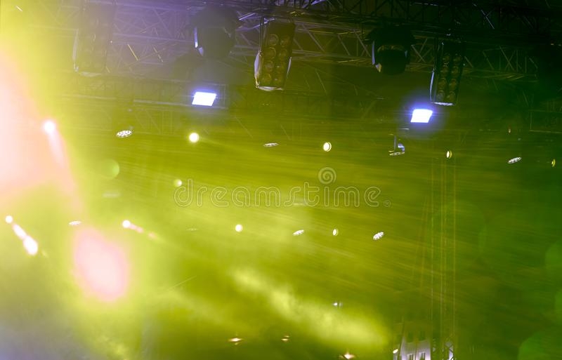 Green lightning of spotlights on concert stage royalty free stock photos