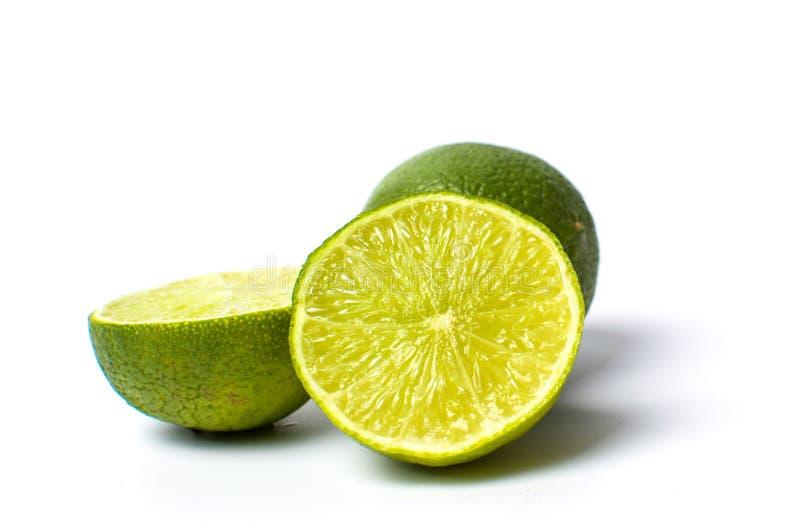 Green lime fruit on white royalty free stock photos