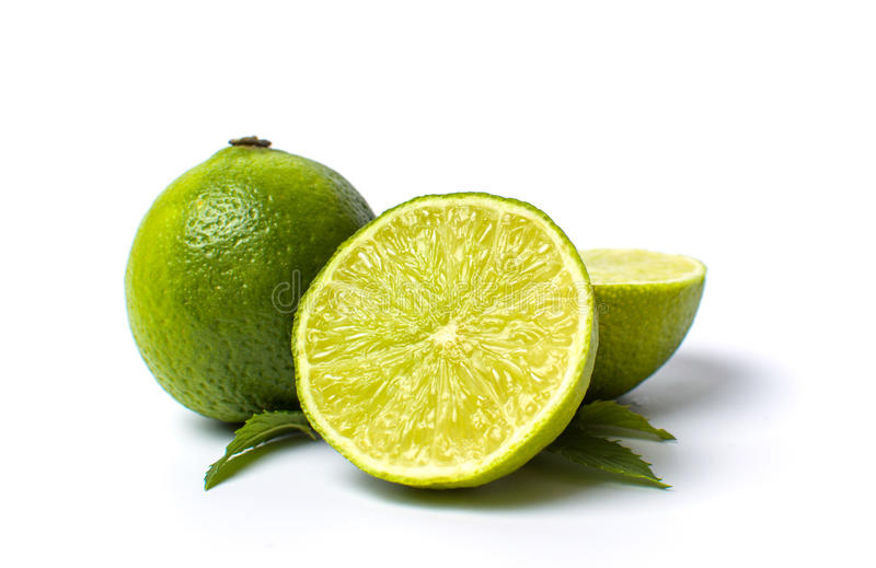 Green lime fruit on white royalty free stock image