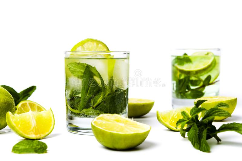 Green lime and mint juice with ice. Refreshing green lime and mint juice isolated stock photo