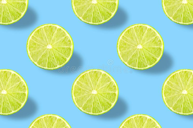 Green lime slice pattern on colorful background royalty free stock photos