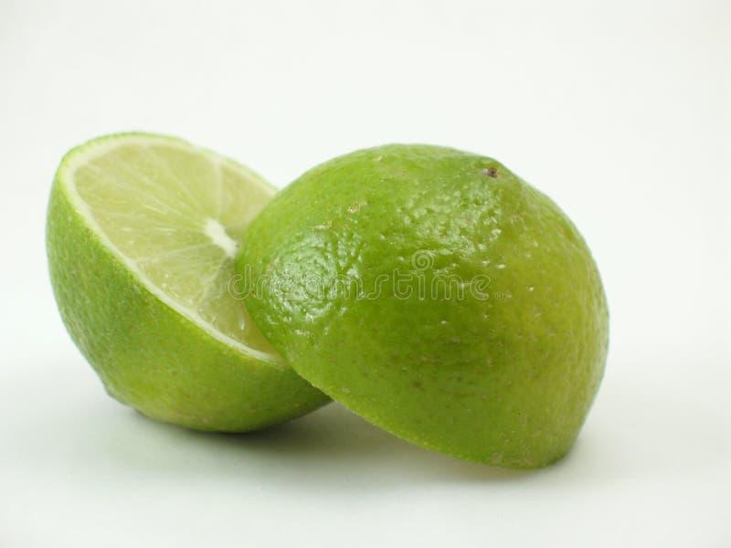 Green lime sliding apart on white stock image