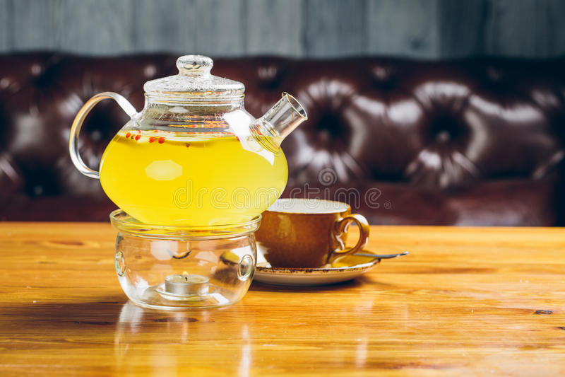 Green lime tea in glass teapot and cup stock photography