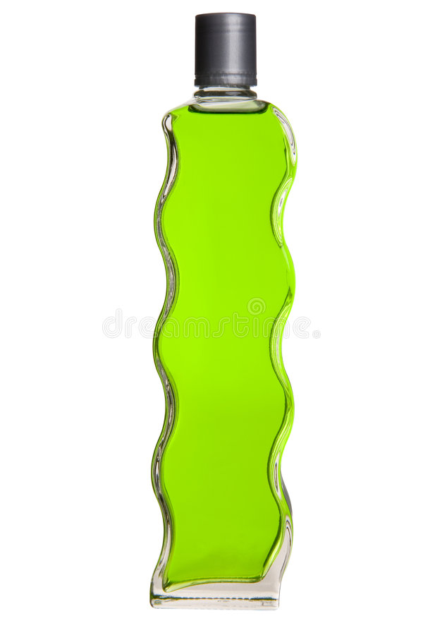 Green Liquid in Curvy Bottle royalty free stock images