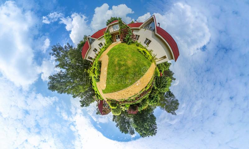 Green little planet panorama with architecture and trees, soft blue sky and white clouds. Buildings at summer. Summer. royalty free stock image