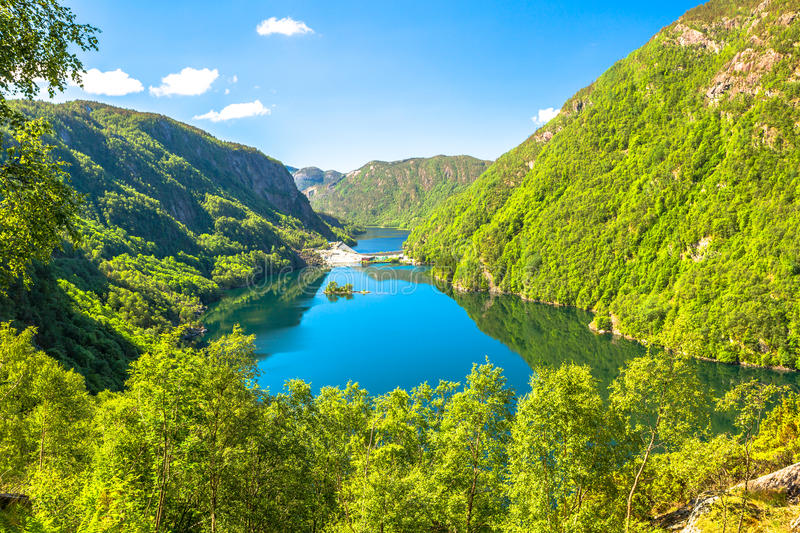 Green Fjords of Norway. View of Fjords in Norway on the scenic Route 13: blue sea and green mountains royalty free stock image