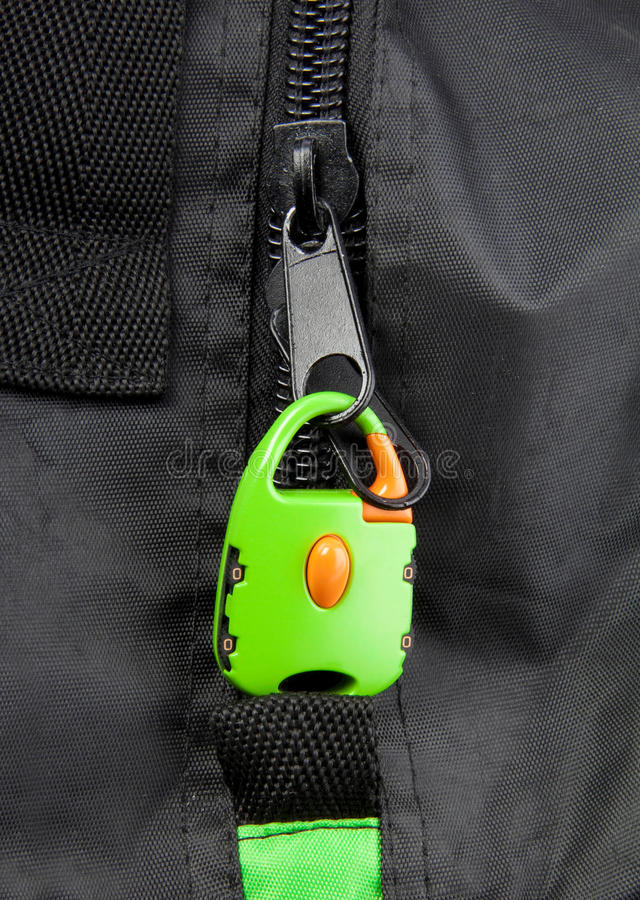 Green lock on a bag's zipper stock image