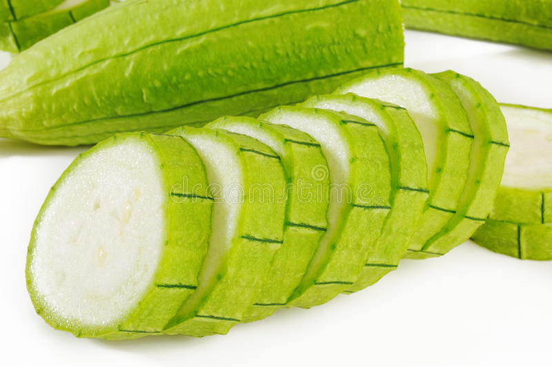 Green loofah gourd on white. Background royalty free stock photos