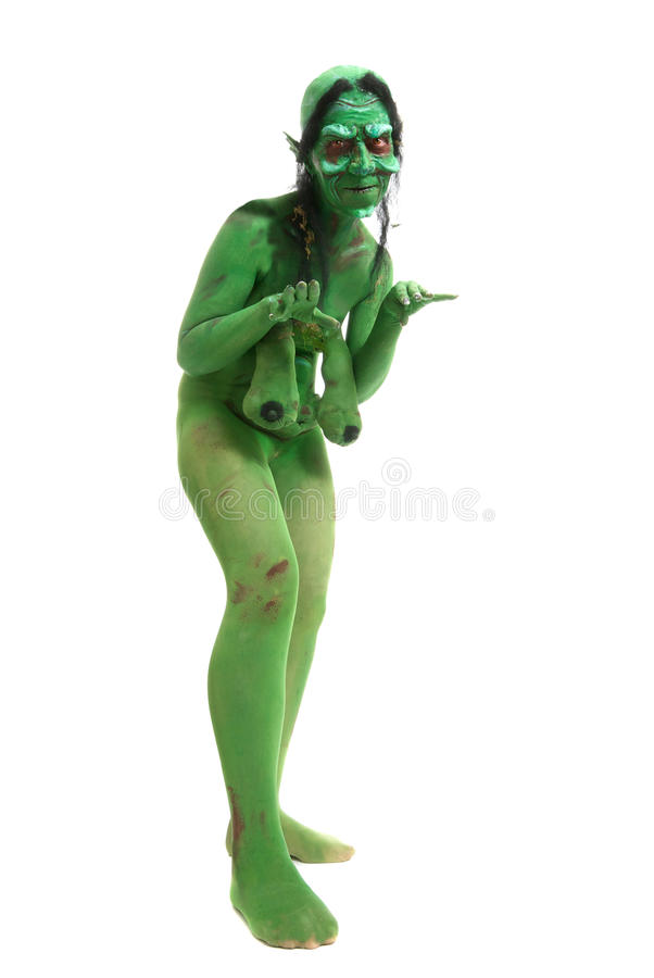 Green looking witch like creature royalty free stock images