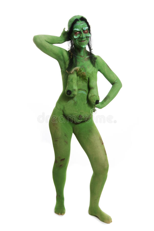 Green looking witch like creature stock images