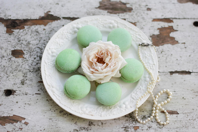 Green Macaroons on a White Plate royalty free stock photo