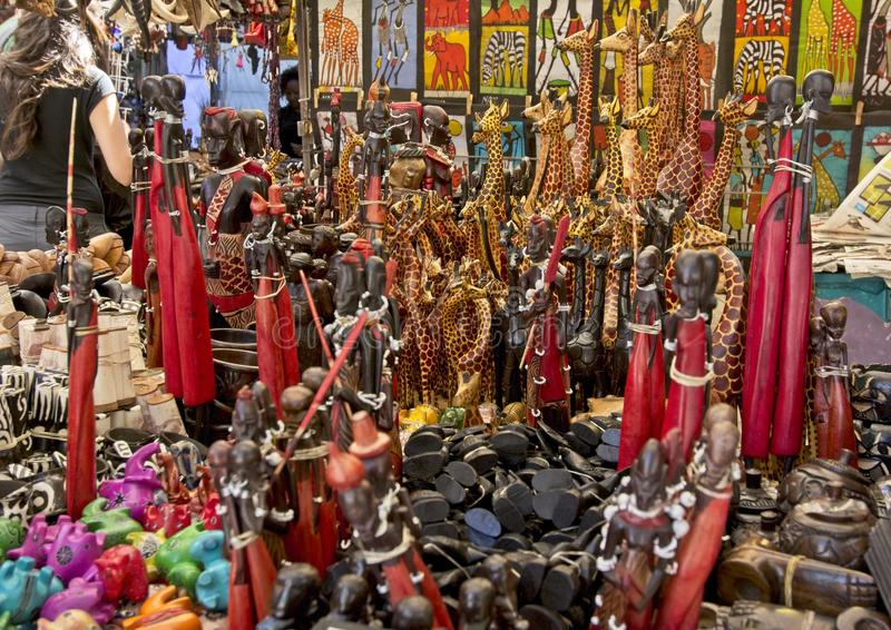 Green Maket Square stall with handmade Wooden African Curios stock image