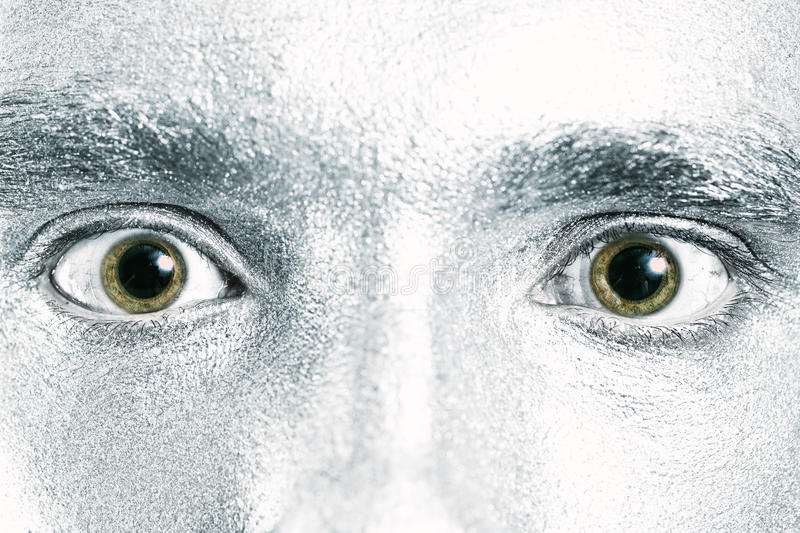 Green male eyes with dilated pupil. Closeup stock photo