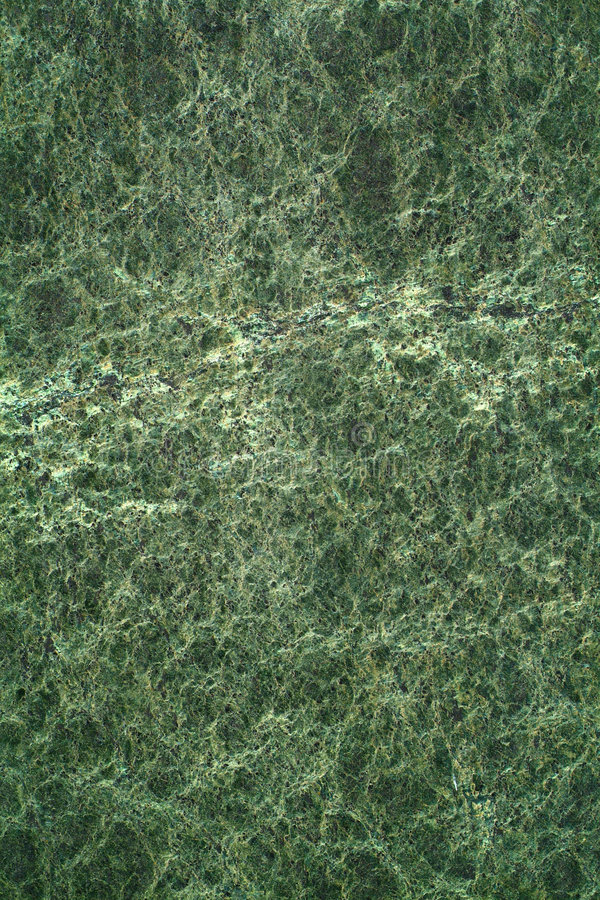 Green marble. A dark green marble texture suitable to use as a background