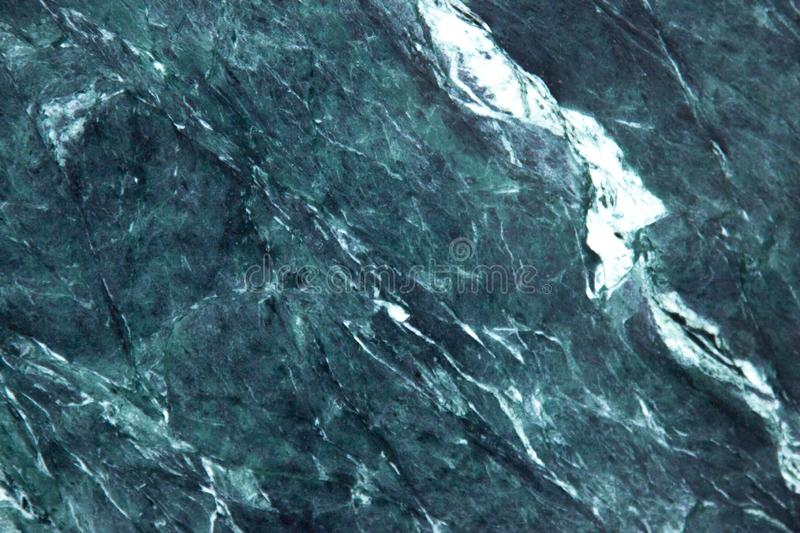 Green marble background close up. Green marble tile surface. Rock texture background. royalty free stock image