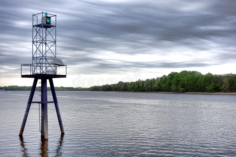 Green Maritime Navigation Beacon Light on River royalty free stock image